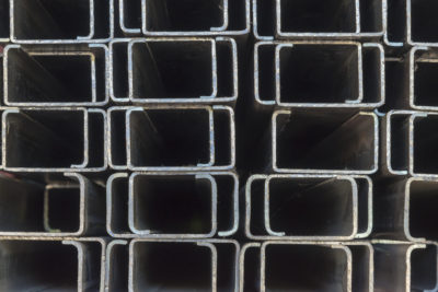 The rectangle C shape of profile pipes.The closeup of the steel bar structure for construction in the shelf.
